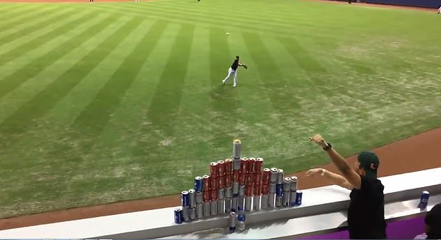 WATCH: Miami Marlins' Outfielder Hits Fans Beer Can Pyramid With Baseball