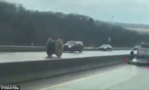 Giant Spool Of Wire Fall Off Truck And Rolls Down Highway Forcing Cars To Veer Out The Way
