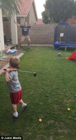 PIE Hole In One:  Little Boy Chips Golf Ball Across the Yard into His Dad