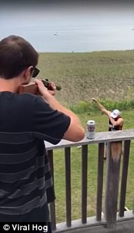 WATCH: Two Men Shotgun a Beer by Shooting a Hole in the Side of it