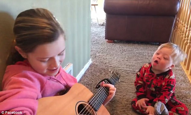 WATCH: 11-year-old Girl Sings to her 2-year-old Brother with Down Syndrome to Teach him Different Words and Phrases