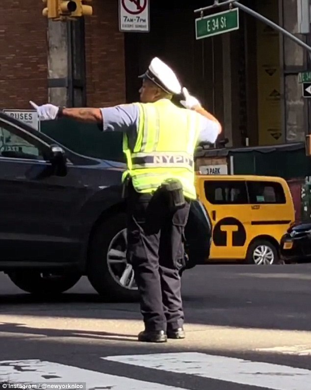 WATCH: Cop Caught Dancing Directing Traffic