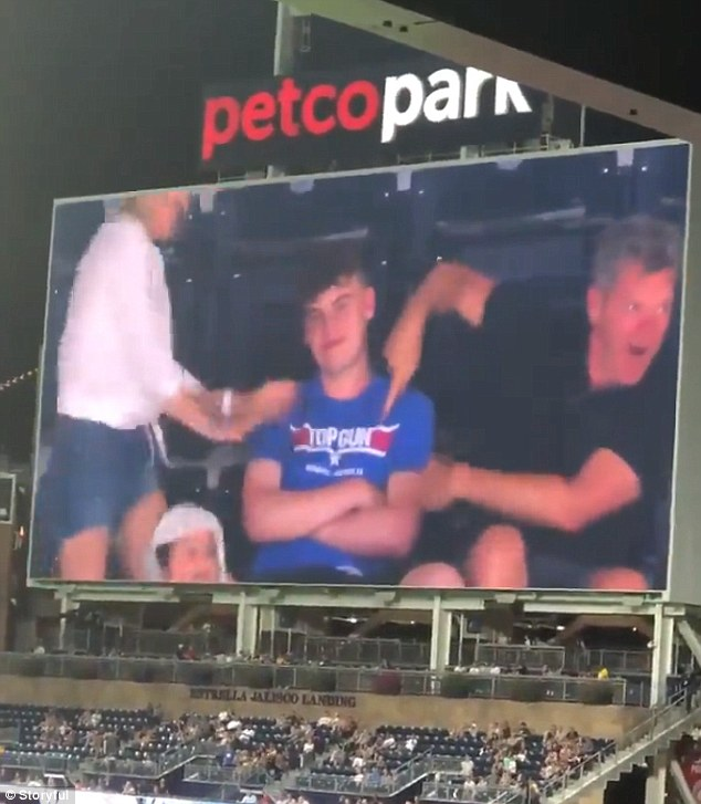 WATCH: Embarrassed Teen Get Sandwiched Between His Dancing Parents On The Jumbotron
