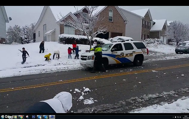 WATCH: Cops Take Break To Have Snowball Fight With Kids