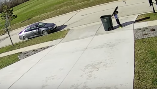 Child Battles Garbage Can and Loses
