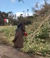 WATCH: Nun with a Chainsaw Clearing Debris After Hurricane Irma
