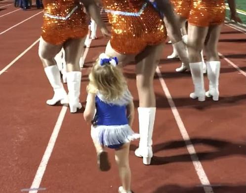 Little Girl Dances Alongside the Majorettes
