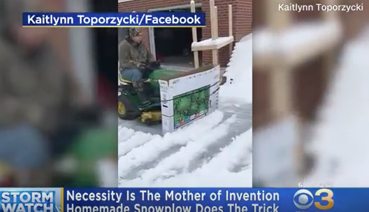Guy Gets Creative... Creates a Snow Plow Using His Lawnmower and a TV Box