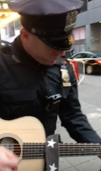 WATCH: NYPD Cop Plays Guitar Licks For Tourists Waiting For Bruce Springsteen Show