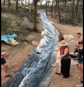 WATCH: Family Creates Giant Water Slide