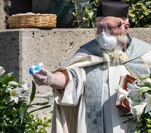 Priest Uses Squirt Gun Filled with Holy Water on Parishioners