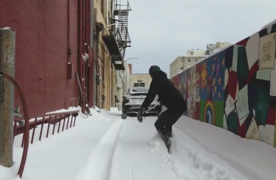 Blog: Dude Skateboards through the Snow, Pulled Behind a Tesla