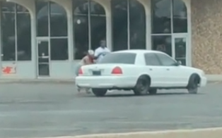 WATCH: Woman Leaves Car Running and the Car Goes For a Joyride