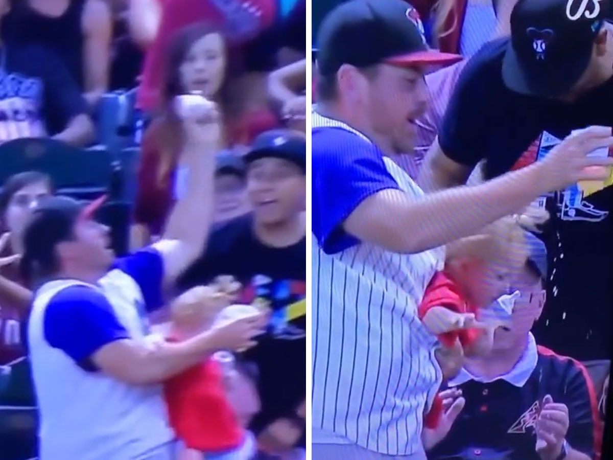 Dad Almost Drops Baby Trying to Catch a Foul Ball